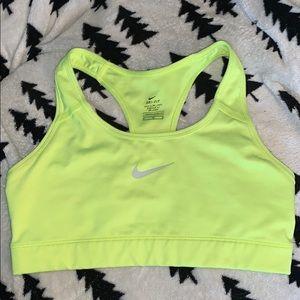 Neon green Nike sports bra